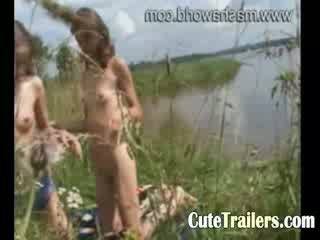 Two amateur girls fingering at lakeside