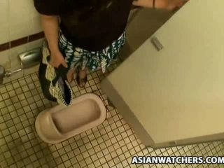Asian schoolgirl masturbates in her schools bathroom