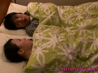 Japanese housewife MILF is titfucking her man