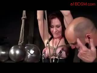 Busty Girl Tortured With Weights Nipple Clips Pussy Stimulated With Vibrator By Master In The Dungeon