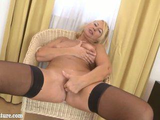 Blonde granny masturbate on the chair in livingroom