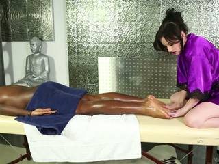 Pale-skinned elegant masseuse and black man.