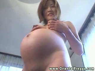Asian preggy lady gets her Melons and tummy massaged
