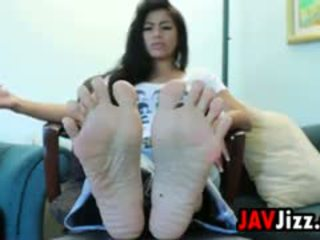 Asian Babe Teases Her Beautiful Soles