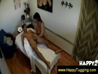 Naughty masseuse grabs a guys Cock