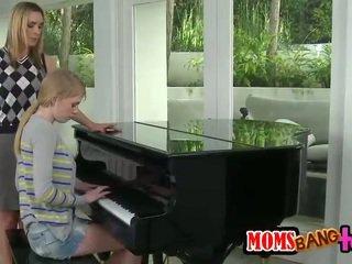 Bossy piano teacher MILF spanks teen a...