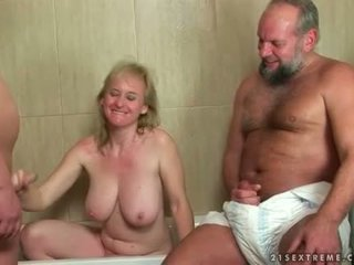 Grandma and two guys in pissing threesome action