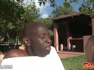 Black yoga teacher drills a white ass