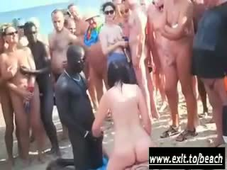 Interracial party on the nude beach Video