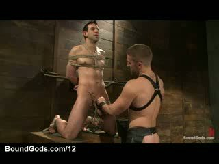 Bound gay cock weighted and clamped in dungeon