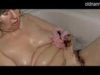 Old grandma pulling dildo in her pussy in the bathroom Video