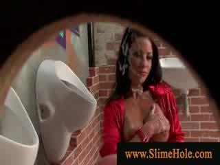 Brunette masturbating with slimy bukkake goo in the restroom