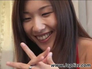 Asian girl showing armpit on the couch