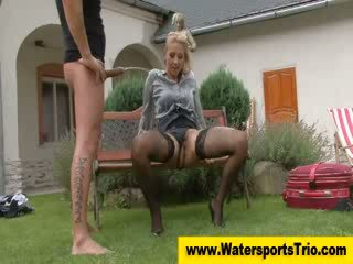 Pissing clothed golden shower out doors couple