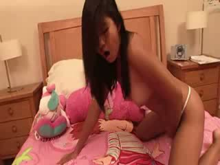 Thai pussy masturbating on the bed