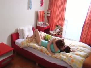 Two Asian hotties gorge on a thick meat pole