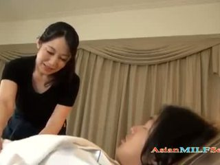 Mature Asian Woman Massaging a lads hairy dick