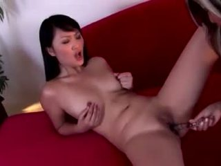 Asian hotties Evelyn Lin and pal enjoy a strap on slit slamming