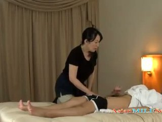 Mature Woman Massaging Guy Giving Handjob Getting Her Tits Rubbed On The Bed