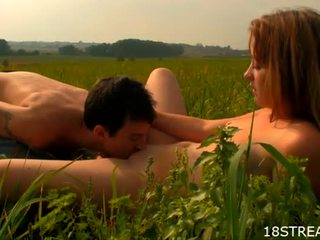 Blonde fucks on a spacious green field