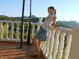 Super cute girl toying on the terrace