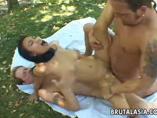 Busty brunette Asian slut gets to be double penetrated