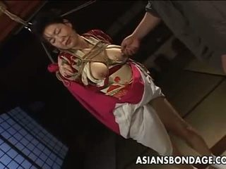 Hot tied up Asian lady with big boobs teased by he