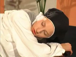 Nun in white stockings gets fucked with dildo and sucks cock