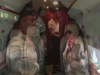 Horny stewardesses suck their clients hard shaft on the plane