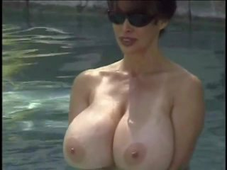 Huge Heavy Tits on a Beautiful Lady Next to the Pool.