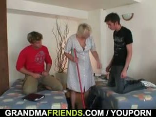 Old cleaning woman takes two cocks