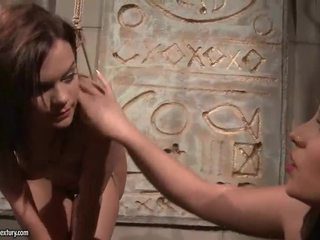 Young mistress punishing her slavegirl