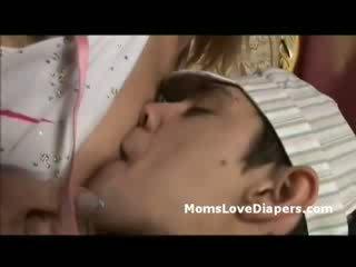 Mature freak breast feeds diaper boy d...
