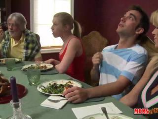 Stepmom jacks off boy under the table