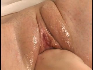Young and pretty pussy in closeup fisting