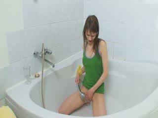 Skinny busty girl showering pussy