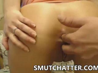 Brunette babe gets her asshole fingered on web cam