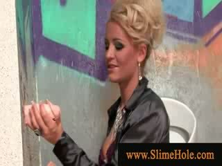 Blondy sucking cock from the gloryhole gets sprayed with cum