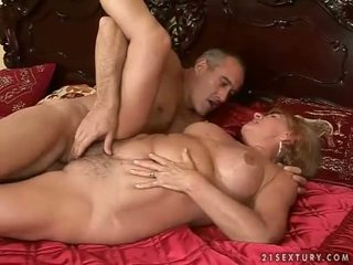 Busty grandma enjoying hard sex